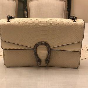 Snake skin look alike snake embellishment bag
